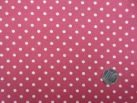 ナチュラル感のある綿麻ドットプリント 生成ドット/濃ピンク地 オックスくらいの厚さの生地 ドットの大きさ4mm