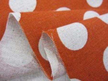 綿麻キャンバスのドットプリント 生成ドット/くすんだオレンジ地 オックスくらいの厚さの生地 ドットの大きさ 3mm