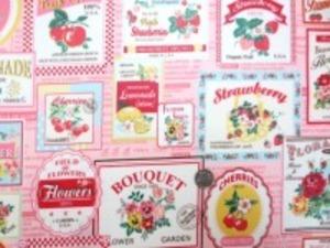 コットンオックスのイチゴ チェリーなどの フルーツ柄のピンク地 ビニールコーティング YUWA
